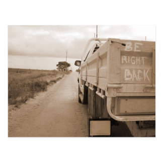 Travel be right back landscape dirt road sky ute postcard
