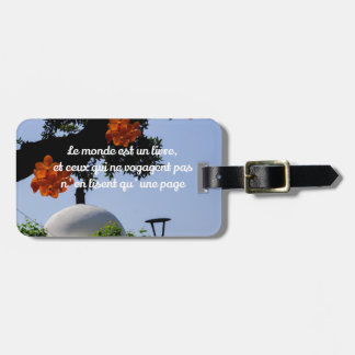 Travelers read the book of the world bag tag