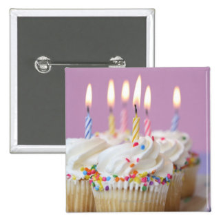 Tray of birthday cupcakes with candles 2 inch square button