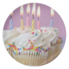Tray of birthday cupcakes with candles plate