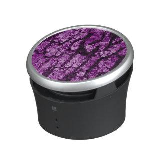 tree bark structure, purple bluetooth speaker