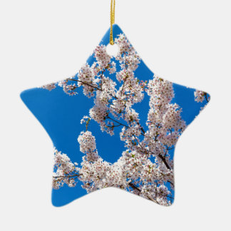 Tree branches with blooming white flowers ceramic star ornament