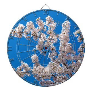 Tree branches with blooming white flowers dartboard
