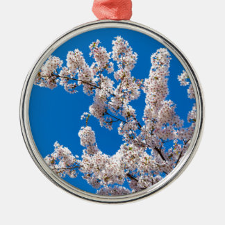 Tree branches with blooming white flowers Silver-Colored round ornament