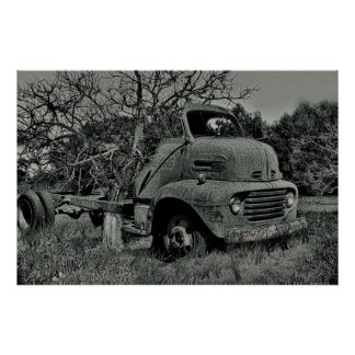 tree growing through old truck in black and white, poster