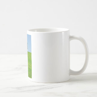 Tree in  a field coffee mug