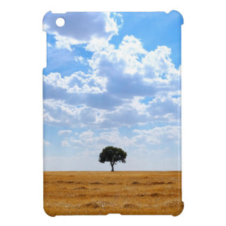 Tree in an harvested wheat field iPad mini cover