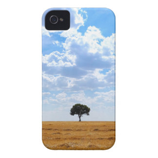 Tree in an harvested wheat field iPhone 4 covers