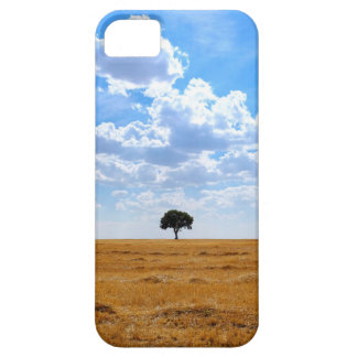 Tree in an harvested wheat field iPhone 5 cases