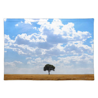 Tree in an harvested wheat field placemat