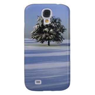 Tree in snow ed landscape