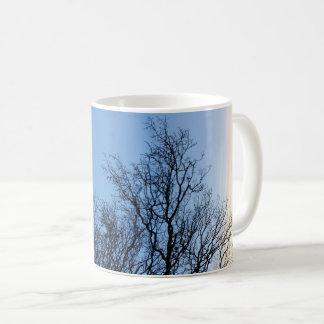 Tree Silhouette in a Blue Winters Sky Coffee Mug