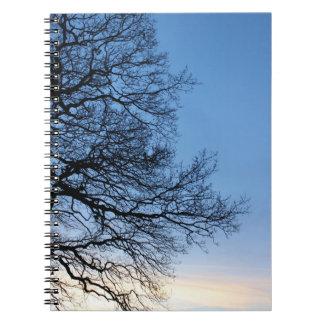 Tree Silhouette in a Blue Winters Sky Notebook