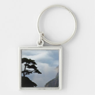 Tree silhouetted at sunrise, Yellow Mountain, Key Chain