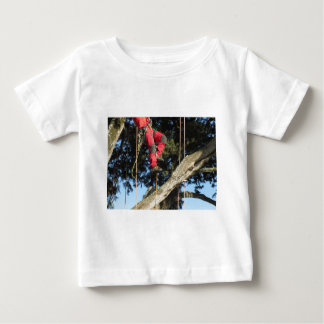Tree surgeon lumberjack hanging from a big tree baby T-Shirt