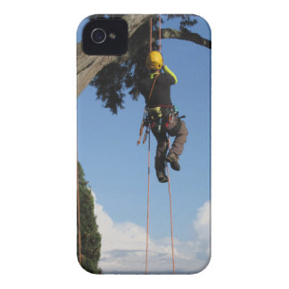 Tree surgeon lumberjack hanging from a big tree iPhone 4 Case-Mate cases