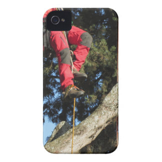 Tree surgeon lumberjack hanging from a big tree iPhone 4 cover