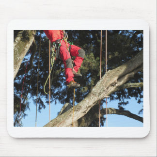 Tree surgeon lumberjack hanging from a big tree mouse pad