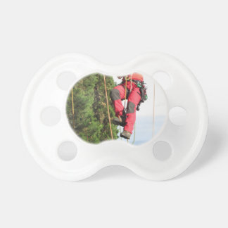 Tree surgeon lumberjack hanging from a big tree pacifier
