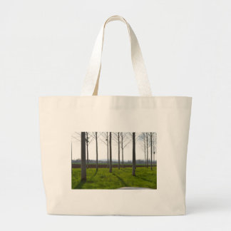 Tree trunks and the French countryside Large Tote Bag