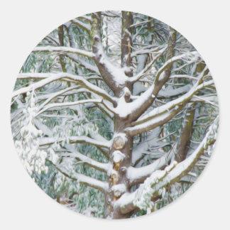 Tree with white fluffy snow round sticker