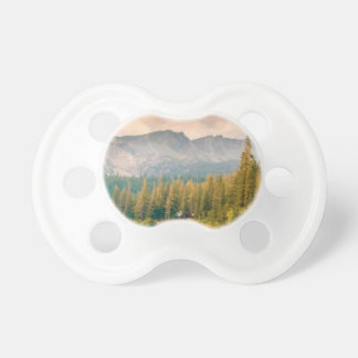 trees mountain and stream pacifier