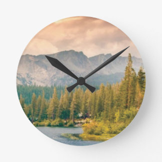 trees mountain and stream round clock