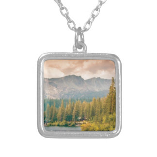 trees mountain and stream silver plated necklace