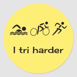 Triathlon pictograms and caption yellow classic round sticker