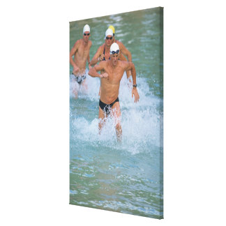 Triathloners Running out of Water 2 Canvas Print