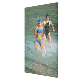 Triathloners Running out of Water Canvas Print