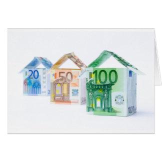 Trois maisons faites de billets de banque carte de vœux