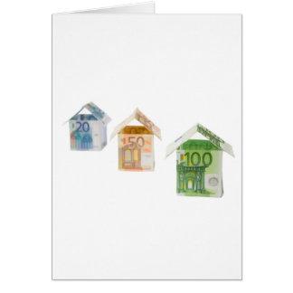 Trois maisons faites d'euro monnaie fiduciaire carte de vœux