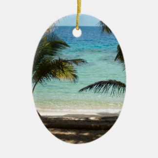 Tropical beach shaded by palms ceramic ornament