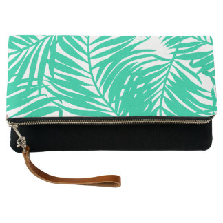 Tropical green palm leaves clutch