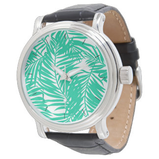 Tropical green palm leaves watch