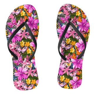 Tropical leaves and flowers flip flops