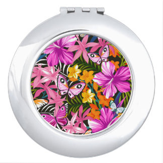Tropical leaves and flowers travel mirror