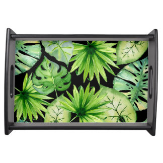 tropical leaves on black serving tray
