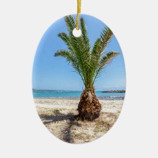 Tropical palm tree on sandy beach ceramic oval ornament