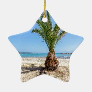 Tropical palm tree on sandy beach ceramic star ornament