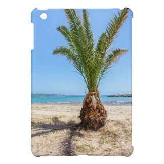 Tropical palm tree on sandy beach iPad mini case