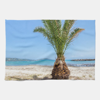 Tropical palm tree on sandy beach kitchen towel
