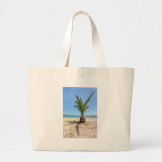 Tropical palm tree on sandy beach large tote bag