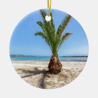 Tropical palm tree on sandy beach round ceramic ornament