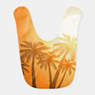 Tropical palm trees at sunset bib
