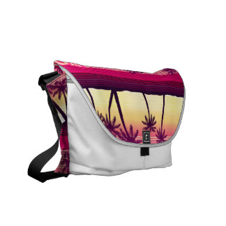 Tropical palms at sunset courier bag