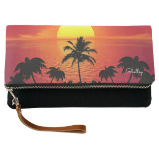 Tropical paradise sunset and palm trees clutch