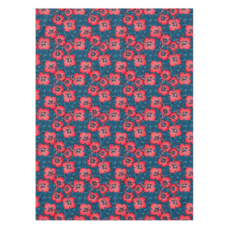 Tropical red flowers on navy tablecloth