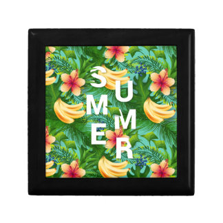 Tropical summer text on banana flowers background gift boxes